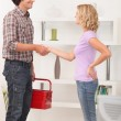 Stock Photo: Maintenance mshaking hand with homeowner.