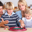 Family playing a game — Stock Photo #8964104