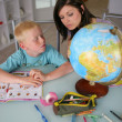 Stock Photo: Mother teaching son geography