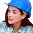 A sceptical tradeswoman - Stock Photo