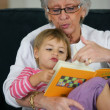 Stock Photo: Grandma and child reading together