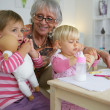 Stock Photo: Grandmother taking care of her grandchildren