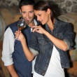 Portrait of a couple tasting wine - Stock Photo