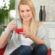 Young woman having a cup of coffee at home — Stock Photo
