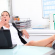 Young woman yawning in front of laptop — Stock Photo #8964927