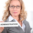 Blond office worker holding administrator badge — Zdjęcie stockowe #8964994