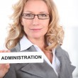 Photo: Blond office worker holding administrator badge
