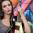 Brunette with electric guitar - Stockfoto