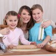 Mother and daughters making bread — Stock Photo