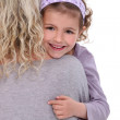 Child hugging a woman — Stock Photo #8965952
