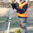 Surveyor on site with a laptop — Stock Photo
