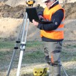 Stock Photo: Surveyor on site with laptop