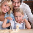 Happy couple and their little girl — Stock Photo