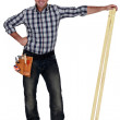 Craftsman holding two wooden boards — Stock Photo #8966447