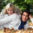 Portrait of a couple on leaves — Stock Photo