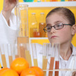 Stockfoto: Schoolgirl dressed as biologist