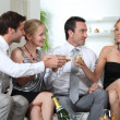 Two couples celebrating with champagne — Stock Photo
