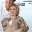 Couple relaxing by the port — Stock Photo