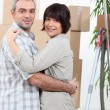 Couple embracing in their new home — Stock Photo #8967281