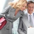Business couple looking at laptop — Stock Photo #8967491