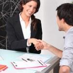 Cheerful woman and man handshaking — Stock Photo