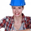 Stock Photo: Tradeswombaring her teeth