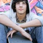 Teenage boy with a skate board — Stock Photo #8968045