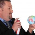 Man spraying globe — Stock Photo