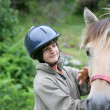 Child with a horse — Stock Photo #8968096