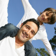 Boy on his father's shoulders — Stock Photo