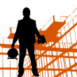 Black silhouette of worker wearing hard hat outdoors near building — Foto Stock