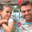 Father and daughter together in the playground — Stock Photo #8968734