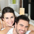 Young couple cheerful laid in bed — Stock Photo