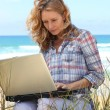 Woman working on the beach — Stock Photo #8969319