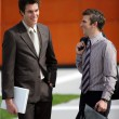 Stock Photo: Two young businessmen sharing joke