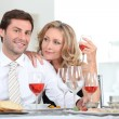 Couple sat at table with wine — Stock Photo #8969653