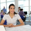 Smiling student in classroom — Stock Photo
