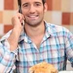 Man on phone at breakfast — Stock Photo