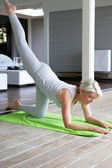 Senior woman doing exercises — Stock Photo