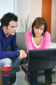 Couple searching the internet — Stock Photo