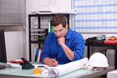 Manual worker completing paperwork — Stock Photo
