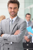 Business man smiling — Stock Photo