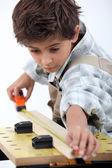 Boy doing carpentry — Stock Photo