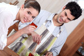Man preparing a meal for his girlfriend — Stock Photo