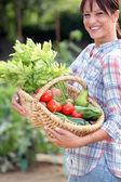 Woman with vegetable basket — ストック写真