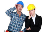 Female architect looking annoyed and foreman by her side — Stock Photo