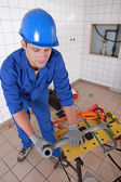 Plumber preparing plastic piping — Stock Photo