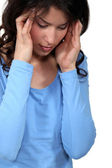 Woman suffering from a headache — Stock Photo