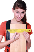 Woman measuring width of laminate flooring — Stock Photo