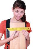 Woman measuring width of laminate flooring — Stock Photo